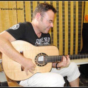 sinto playing guitar